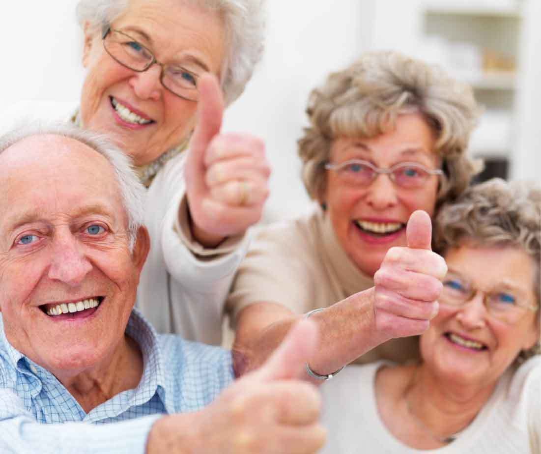 Seniors Laughing with thumbs up