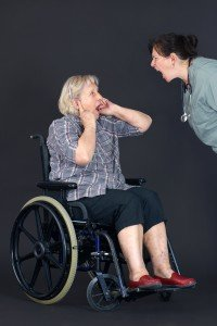 Mean caregiver yelling at elderly woman in wheelchair