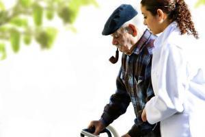 Alzheimer disease behavioral therapies nurse walking with patient