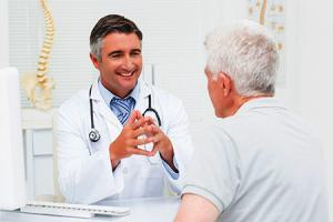 Orthopedic doctor discussing with senior patient