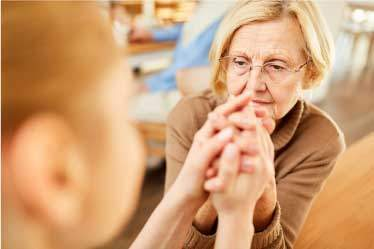 Concerned woman holding moms hand