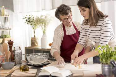 Mother and daughter reading a recipe together