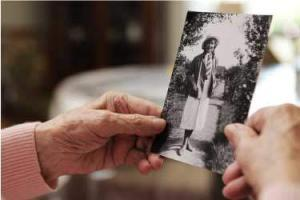 Old hands holding picture