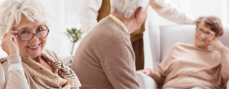 Assisted Living Facility seniors in living room conversation